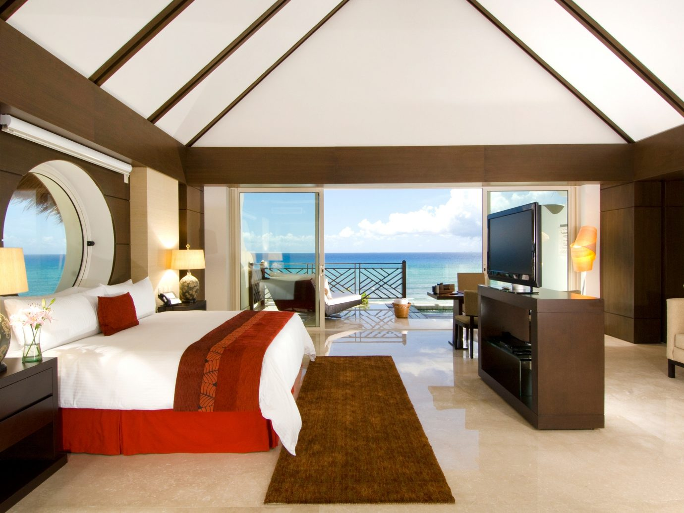 All-Inclusive Resorts Balcony Beach Bedroom Elegant Family Travel Hotels Luxury Modern Romance Romantic Scenic views Suite indoor floor room wall sofa bed ceiling property Living estate hotel living room Villa real estate home Resort interior design furniture cottage Design condominium apartment area