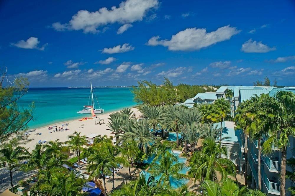 Hotels sky caribbean outdoor ecosystem Resort vacation Beach Nature Sea Coast bay tourism tropics Lagoon Ocean Island blue arecales estate plant shore