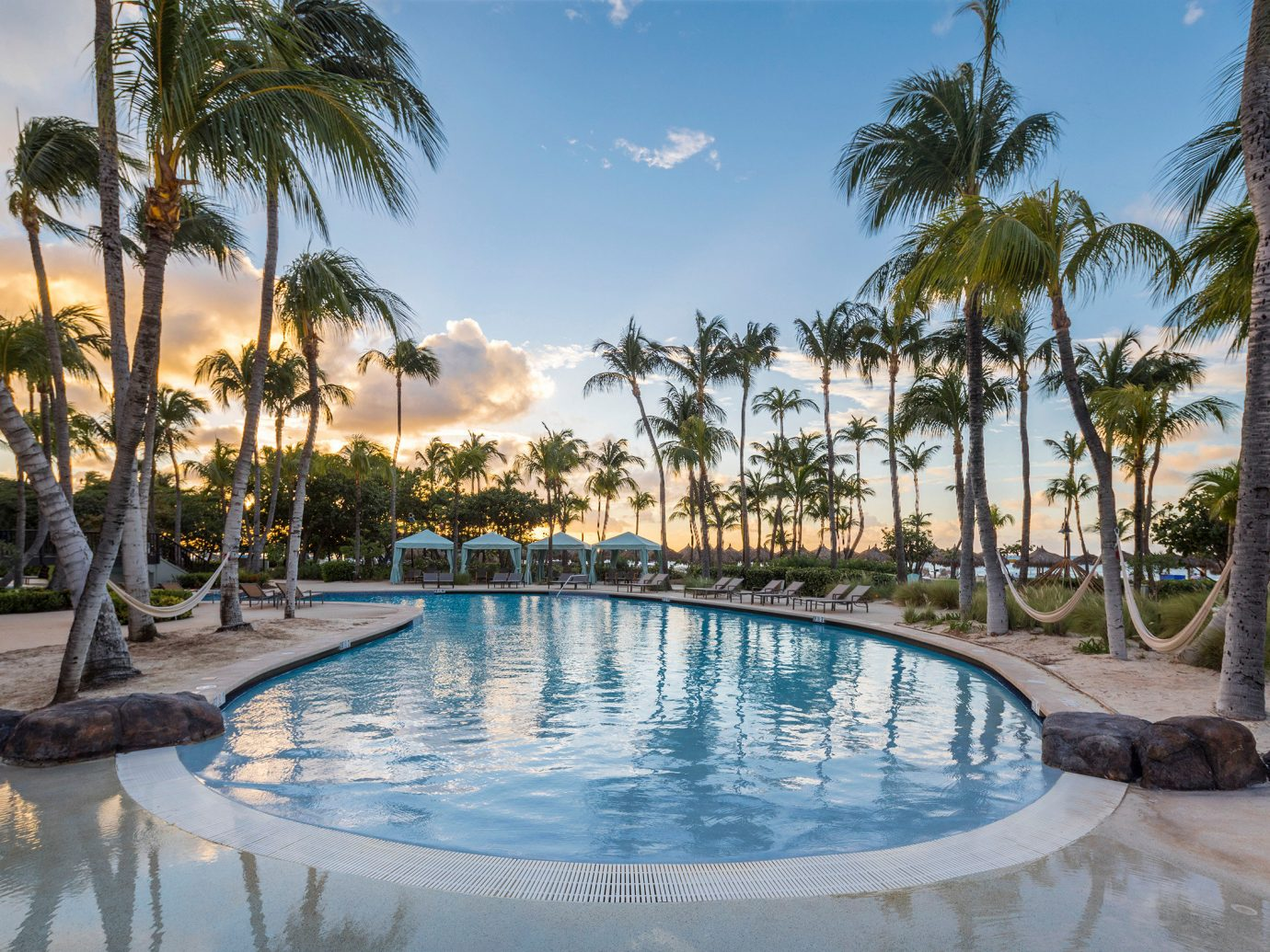Trip Ideas tree outdoor water sky palm swimming pool Pool property Resort leisure vacation estate arecales resort town Villa real estate Lake caribbean Lagoon plant lined swimming shore several sandy