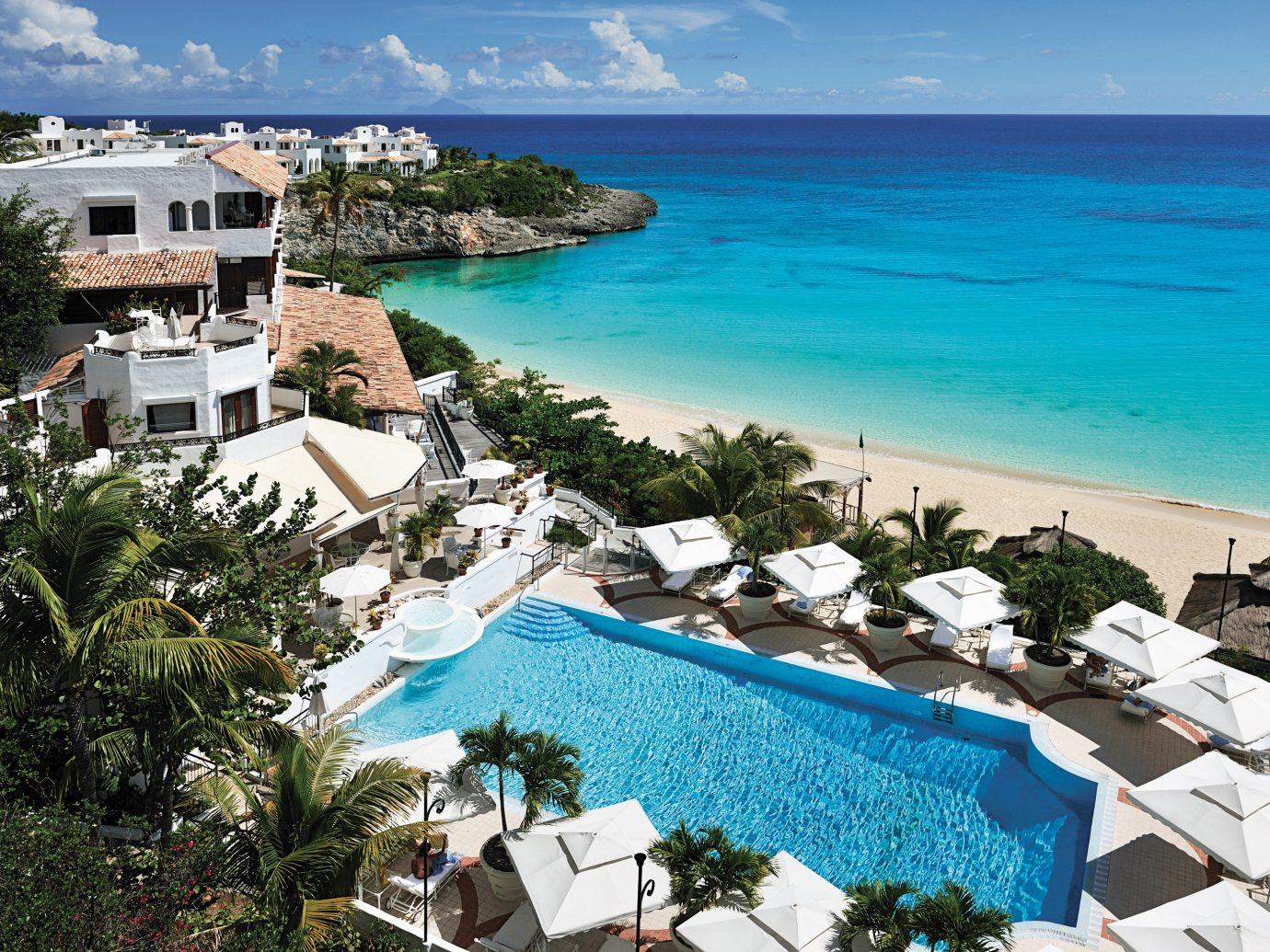 Beach Beachfront Family Hotels Luxury Resort Scenic views outdoor tree water leisure Nature property swimming pool vacation caribbean Sea estate bay Coast tourism Ocean resort town Lagoon cape Villa cove Water park marina blue reef shore surrounded
