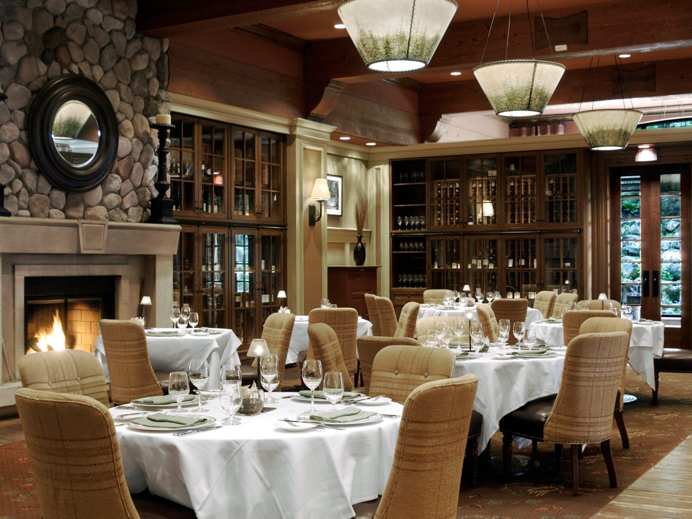 Adventure Dining Drink Eat Mountains + Skiing Rustic Trip Ideas indoor floor restaurant room ceiling meal estate function hall Resort interior design Fireplace furniture