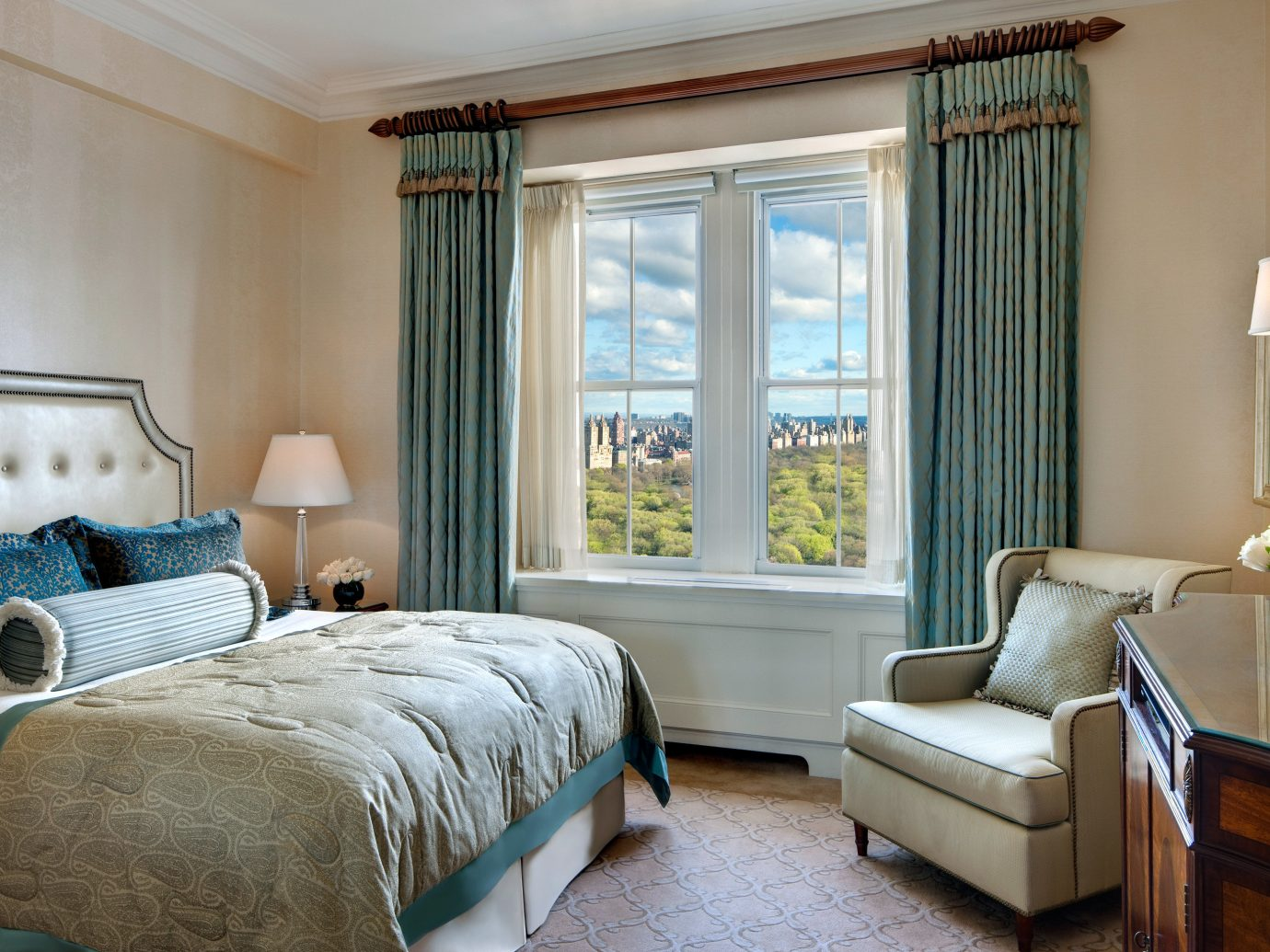 Bedroom City Hotels Luxury Luxury Travel Romantic Hotels Scenic views indoor sofa wall room floor bed window property hotel Living living room home estate interior design Suite cottage real estate green furniture window covering pillow curtain window treatment decorated lamp containing tan