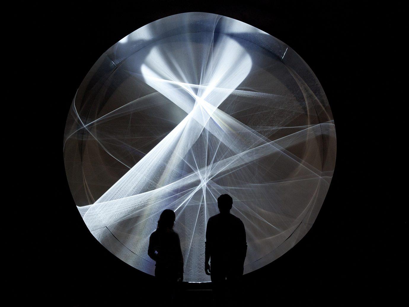Arts + Culture light circle sandglass organ sphere shape reflection symmetry dark