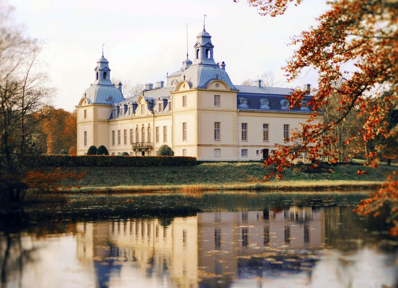Denmark Finland Hotels Landmarks Luxury Travel Sweden tree outdoor water sky reflection château River building water castle season autumn Lake Winter waterway evening estate castle park day