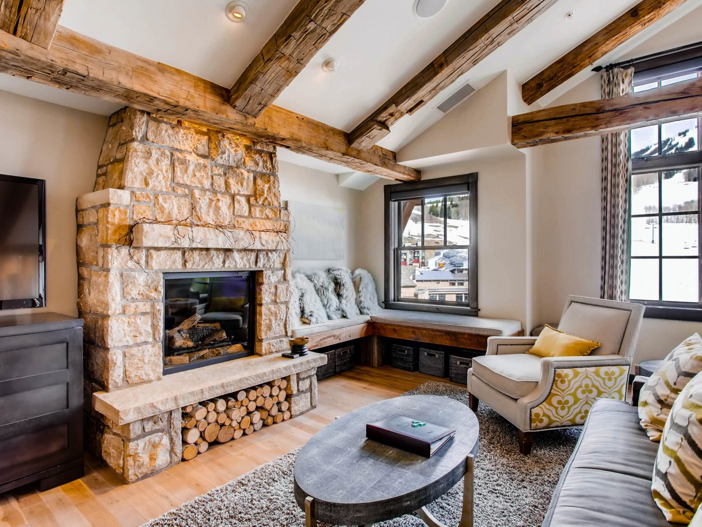 Fall Travel Mountains + Skiing National Parks Outdoors + Adventure Trip Ideas indoor Living Fireplace room floor living room window fire interior design real estate furniture estate hearth interior designer stone