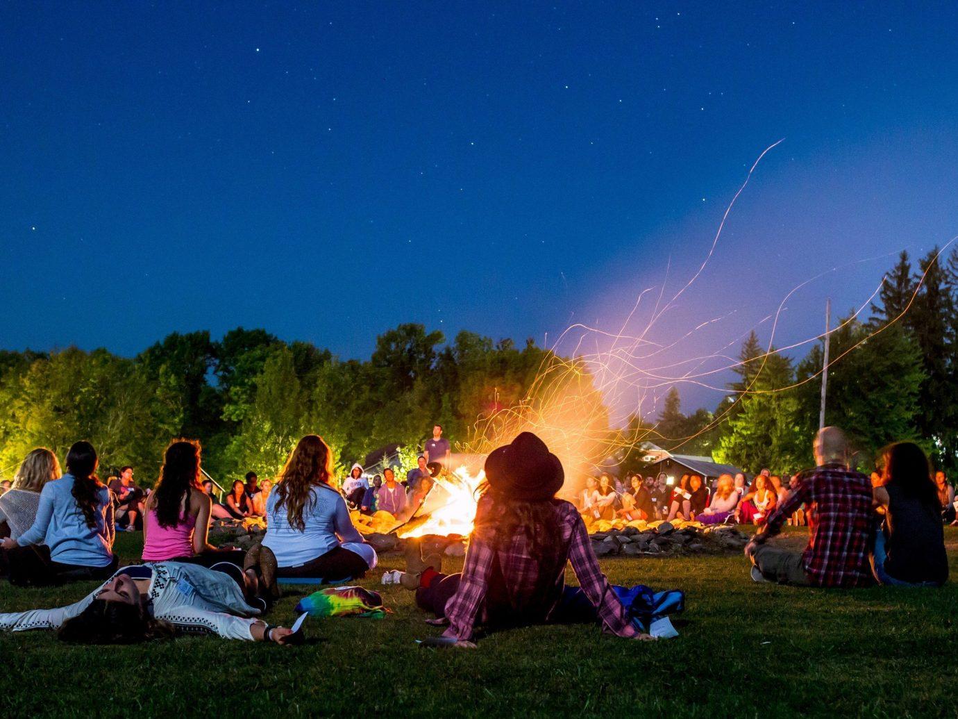 Offbeat person outdoor grass night campfire screenshot
