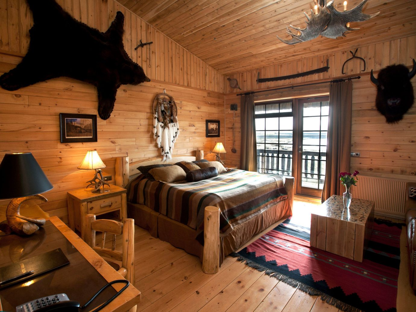 bed Bedroom Cabin charming cozy homey Hotels Iceland interior Lodge log cabin Luxury Rustic Trip Ideas warm indoor floor room property living room window house estate home cottage hardwood interior design wood farmhouse Design Suite recreation room furniture