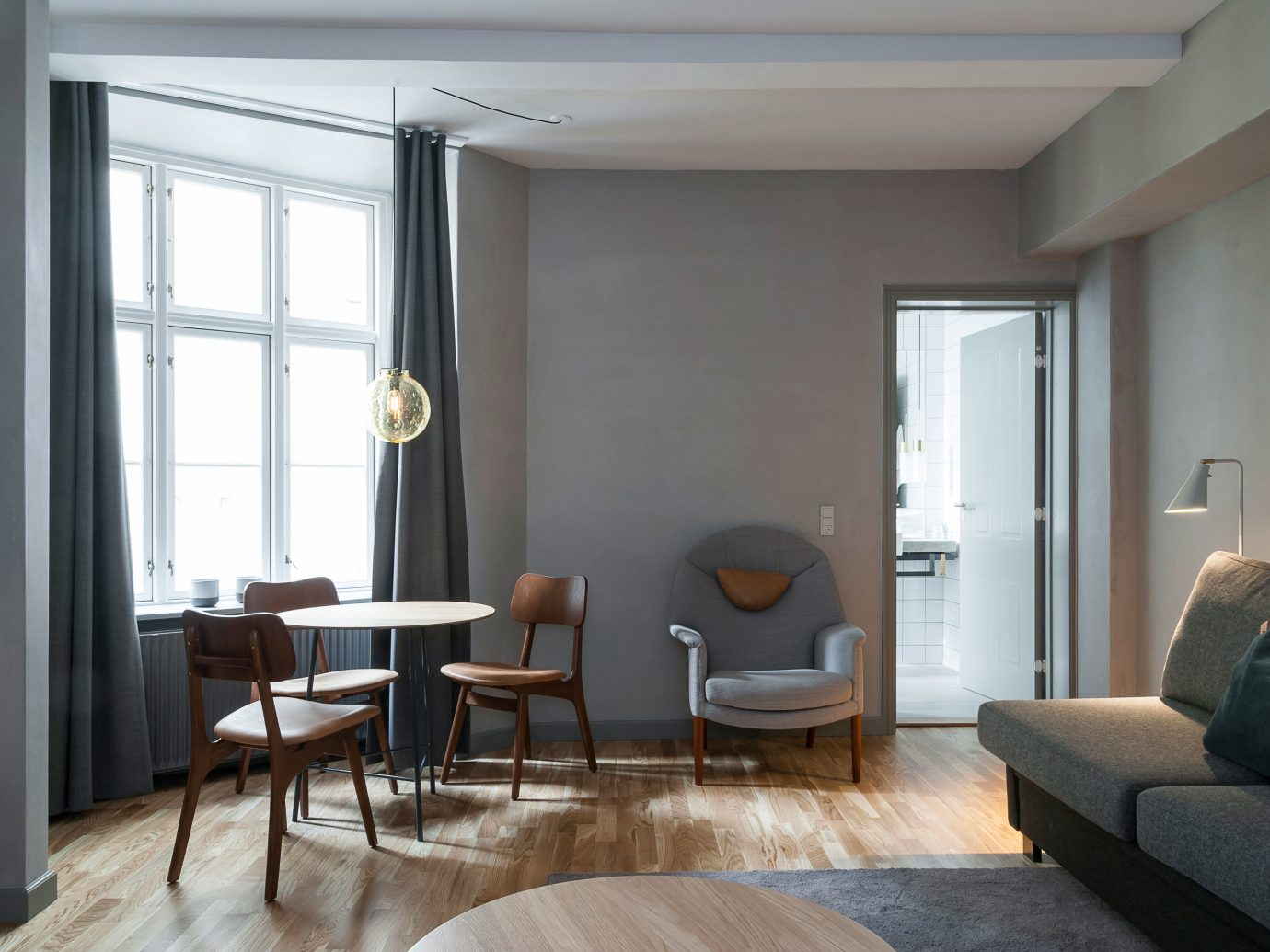 Boutique Hotels Copenhagen Denmark Hip Hotels Living Lounge Luxury Scenic views indoor floor wall room window ceiling property chair living room home interior design real estate hardwood condominium estate cottage apartment furniture area