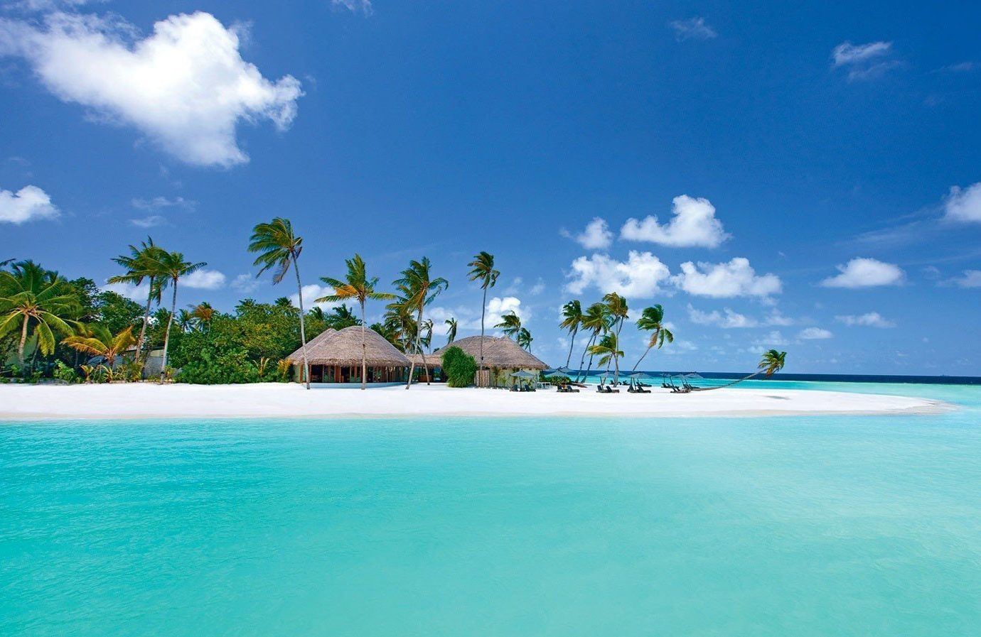 Hotels Trip Ideas sky water outdoor Nature landform caribbean geographical feature reef Sea Beach Ocean vacation blue Island Lagoon atoll islet bay tropics shore archipelago swimming pool cape cay Resort clouds swimming day