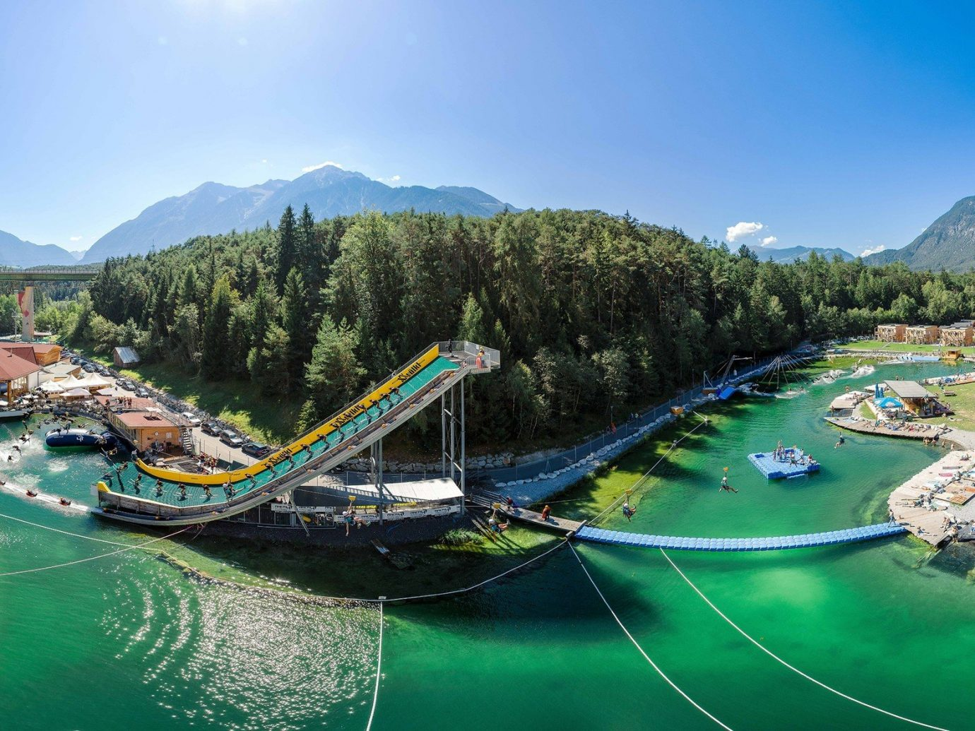 Trip Ideas mountain sky Boat amusement park outdoor leisure park green Nature Water park tourism Resort outdoor recreation recreation mountain range aerial photography amusement ride nonbuilding structure docked colorful
