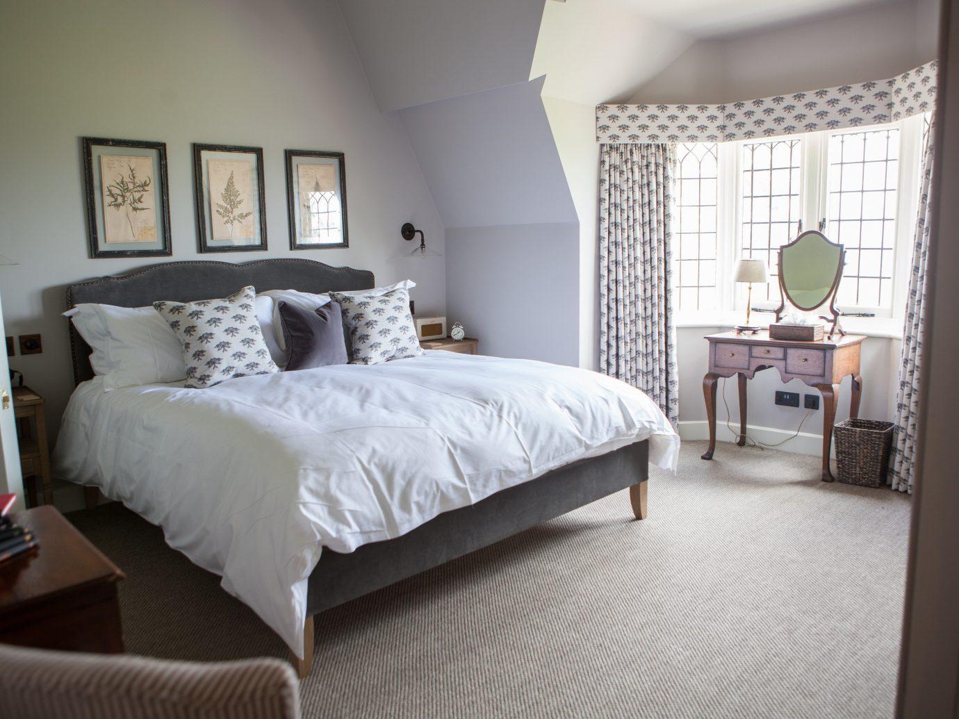 Trip Ideas indoor bed wall room Bedroom floor property hotel cottage interior design hardwood home estate Suite bed frame furniture real estate living room bed sheet apartment