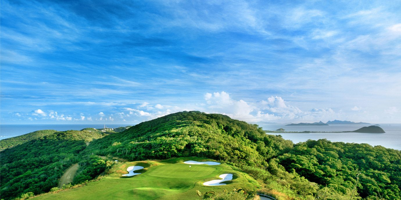 Travel Tips sky outdoor Nature water mountain geographical feature landform Coast cloud horizon hill Sea grass Ocean mountain range landscape bay cape terrain overlooking meadow aerial photography grassy golf course cliff hillside lush day highland