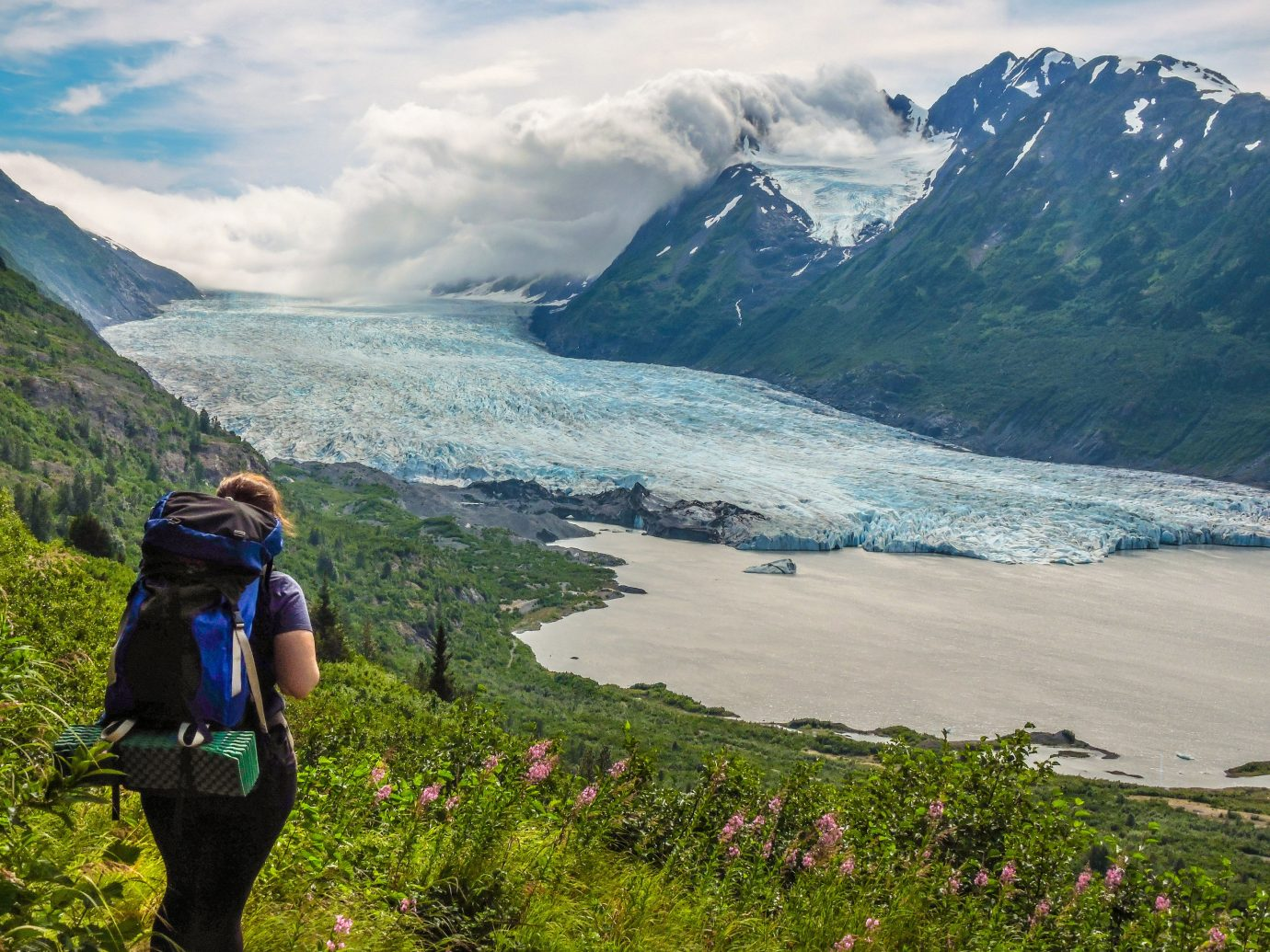 Outdoors + Adventure mountain outdoor sky Nature highland mountainous landforms landform geographical feature mountain range wilderness fjord fell vacation loch walking Adventure alps Lake glacial landform hiking glacier backpacking ridge plateau mountain pass
