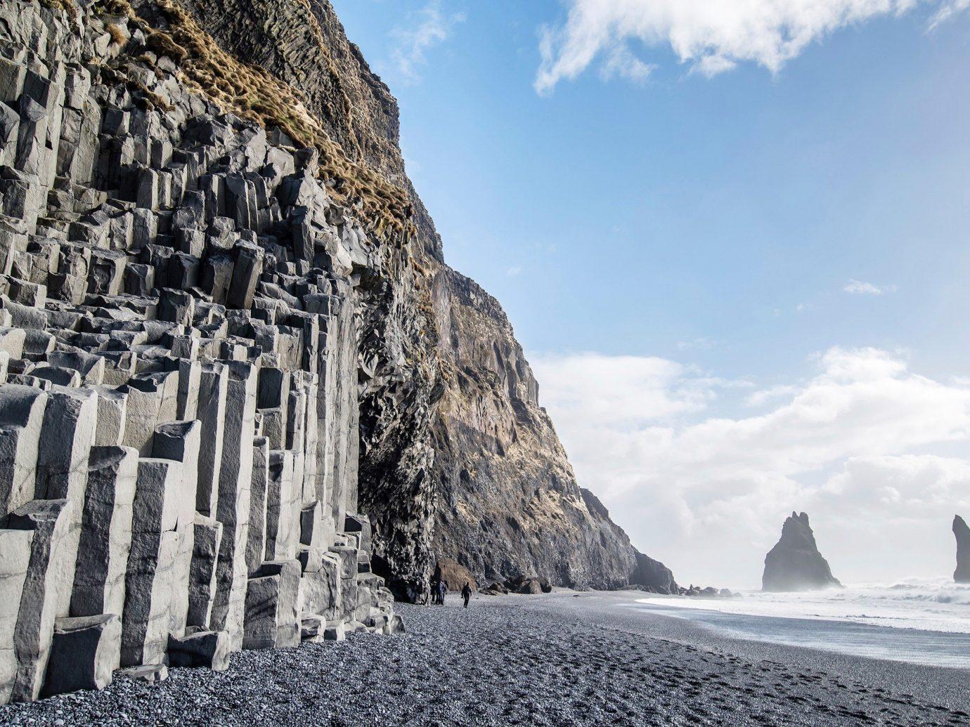Travel Tips sky outdoor mountain Nature landmark rock cliff Coast terrain ice formation Sea day