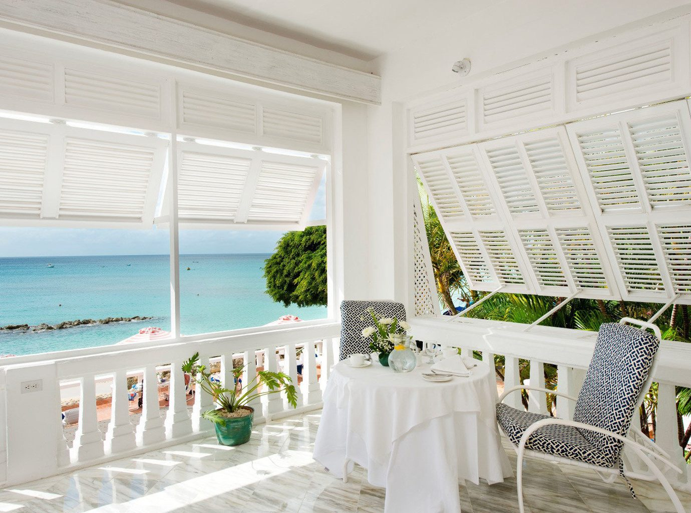 Balcony Beach Beachfront Country Elegant Island Lounge Nature Outdoors Scenic views Terrace Trip Ideas Waterfront window indoor room property interior design white estate home window covering real estate porch furniture