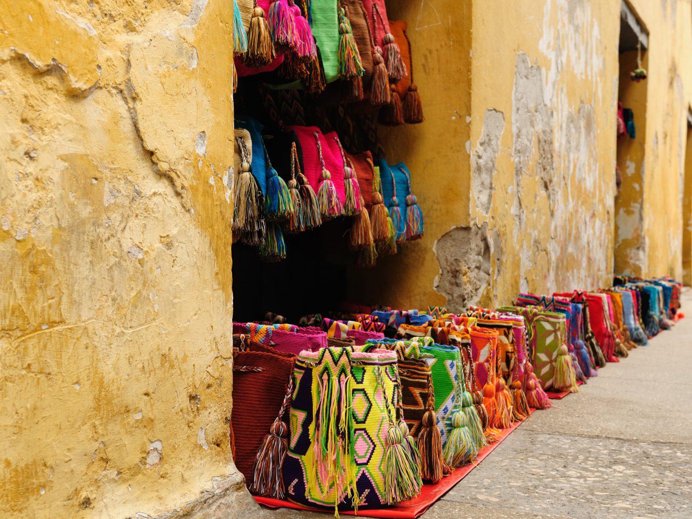 Travel Tips Trip Ideas color red outdoor yellow wall art colorful street ancient history wood temple tradition travel colored bright painted