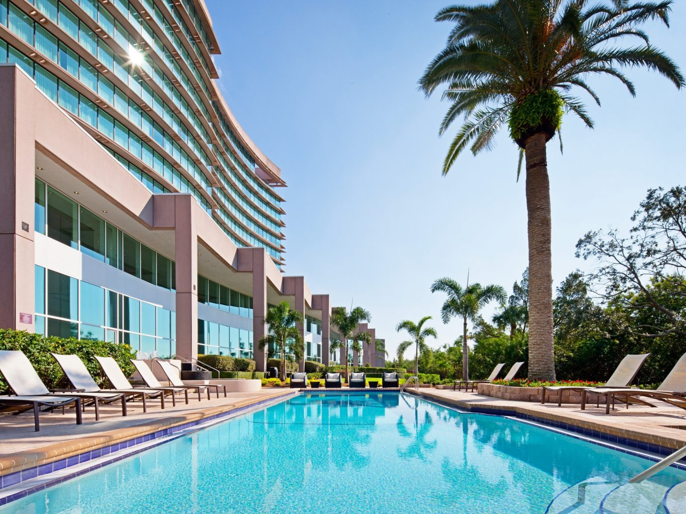 Hotels outdoor building Resort Pool swimming pool leisure condominium property estate vacation real estate Villa plaza arecales palm lined swimming