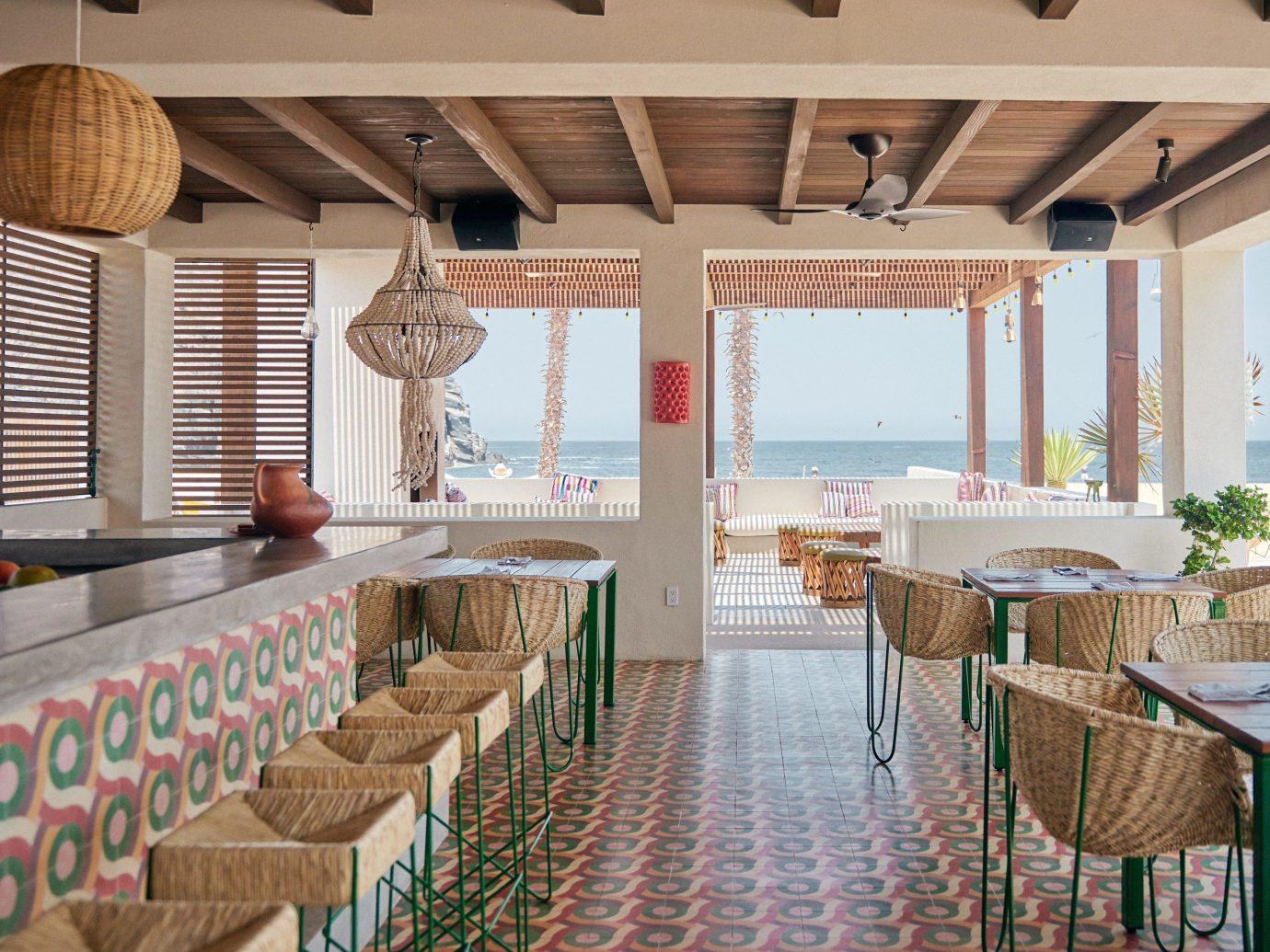 Beach Honeymoon Hotels Mexico Romance Tulum indoor floor chair room restaurant ceiling real estate interior design Resort estate table apartment furniture area several