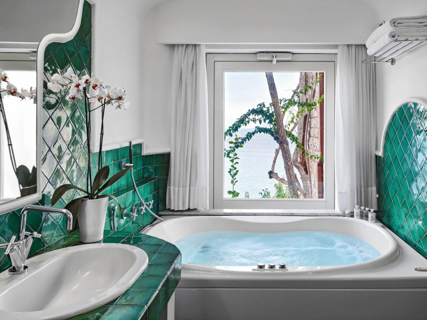 Honeymoon Hotels Luxury Travel Romance wall indoor bathroom room sink green tub bathtub interior design toilet swimming pool home plumbing fixture estate window Bath tiled