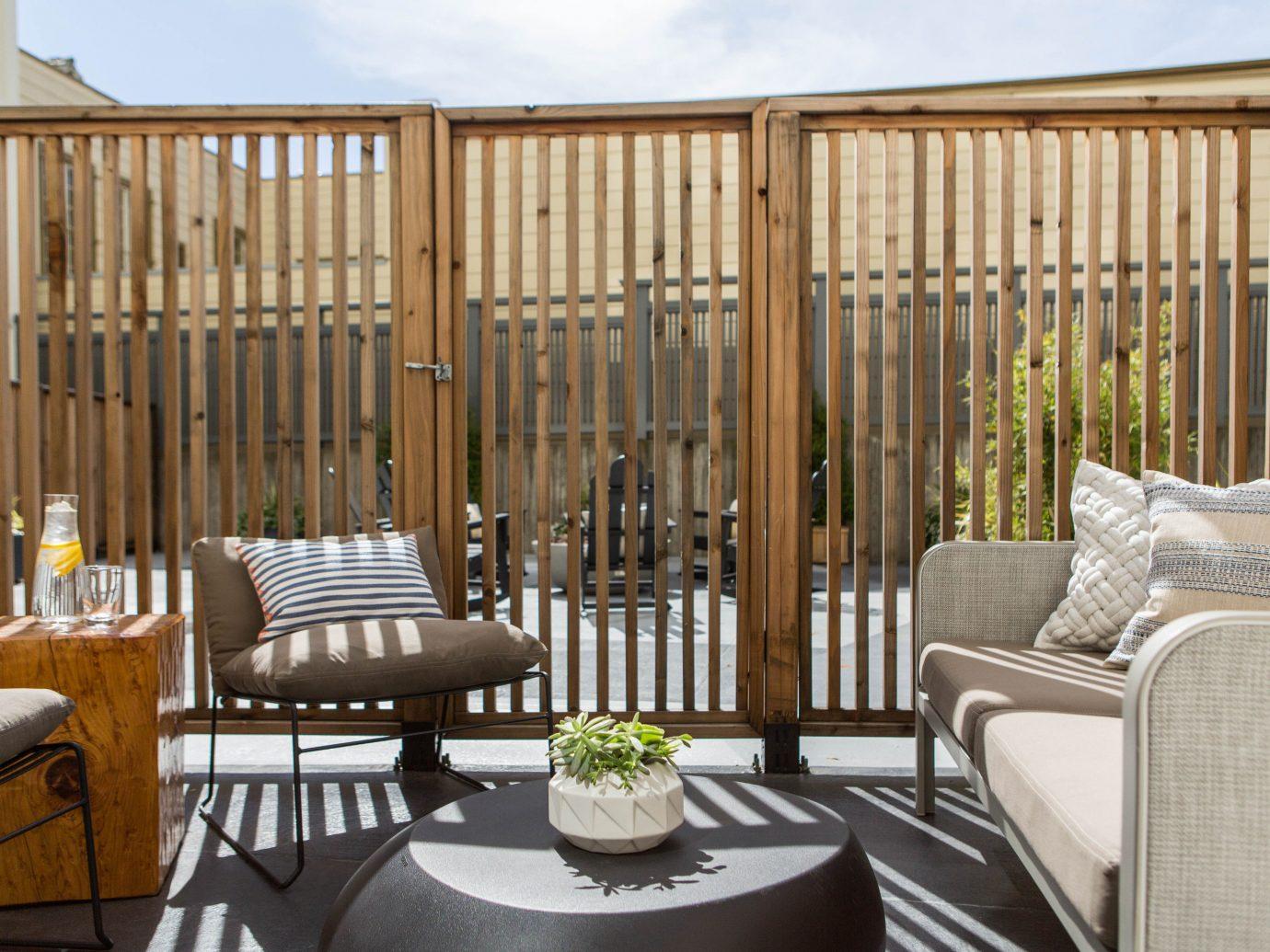 Hotels chair indoor floor room property Living porch outdoor structure wood home estate interior design real estate baluster furniture area