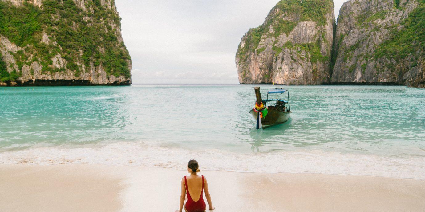 Hotels Travel Tips Trip Ideas water outdoor mountain Beach Sea body of water Nature shore vacation Ocean Coast bay Island caribbean Lagoon sand wave tropics cape cove