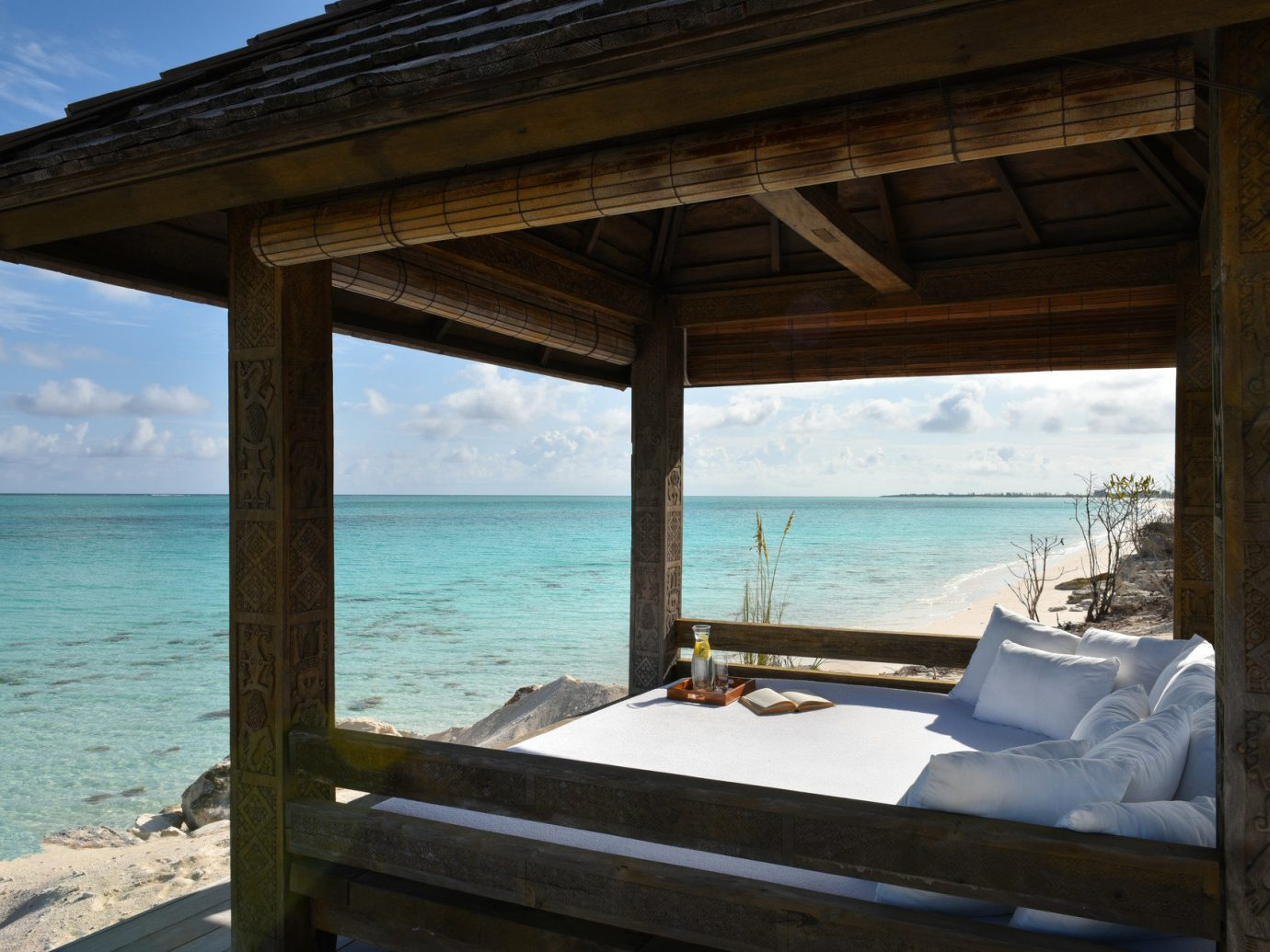 Beach front seating at COMO Parrot Cay, Turks and Caicos