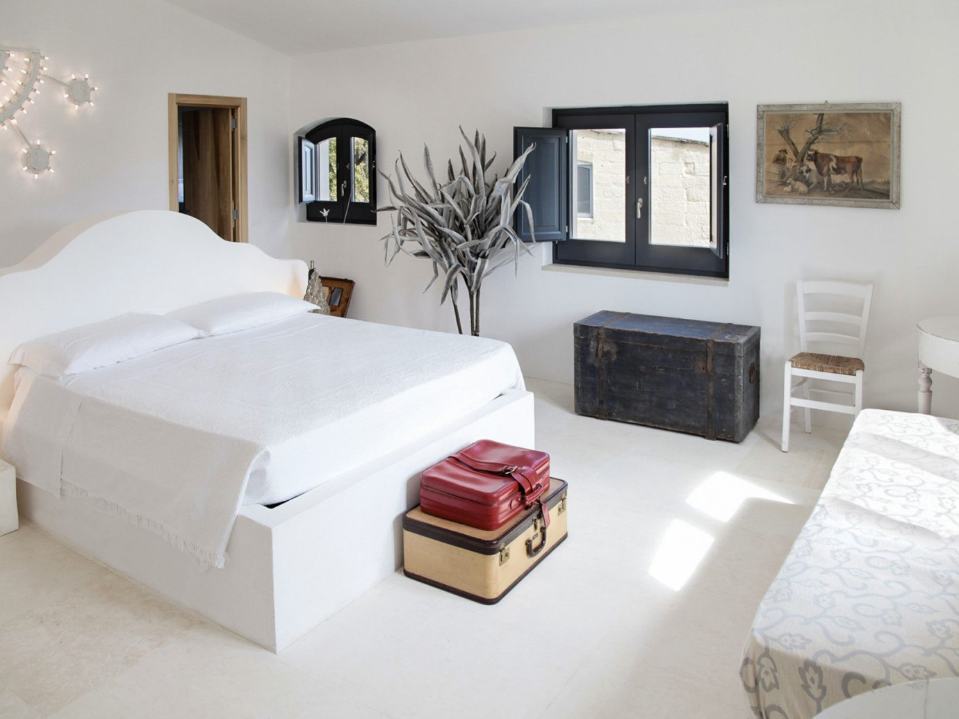 Boutique Hotels Hotels Trip Ideas wall indoor sofa floor bed frame room Bedroom property Living furniture bed home white interior design mattress bed sheet Suite living room decorated