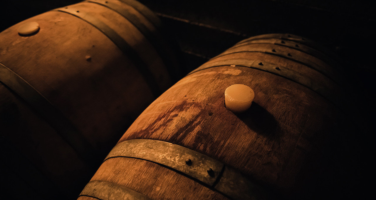 Food + Drink man made object indoor darkness close up light wood macro photography temple dark musical instrument wine barrel close tan