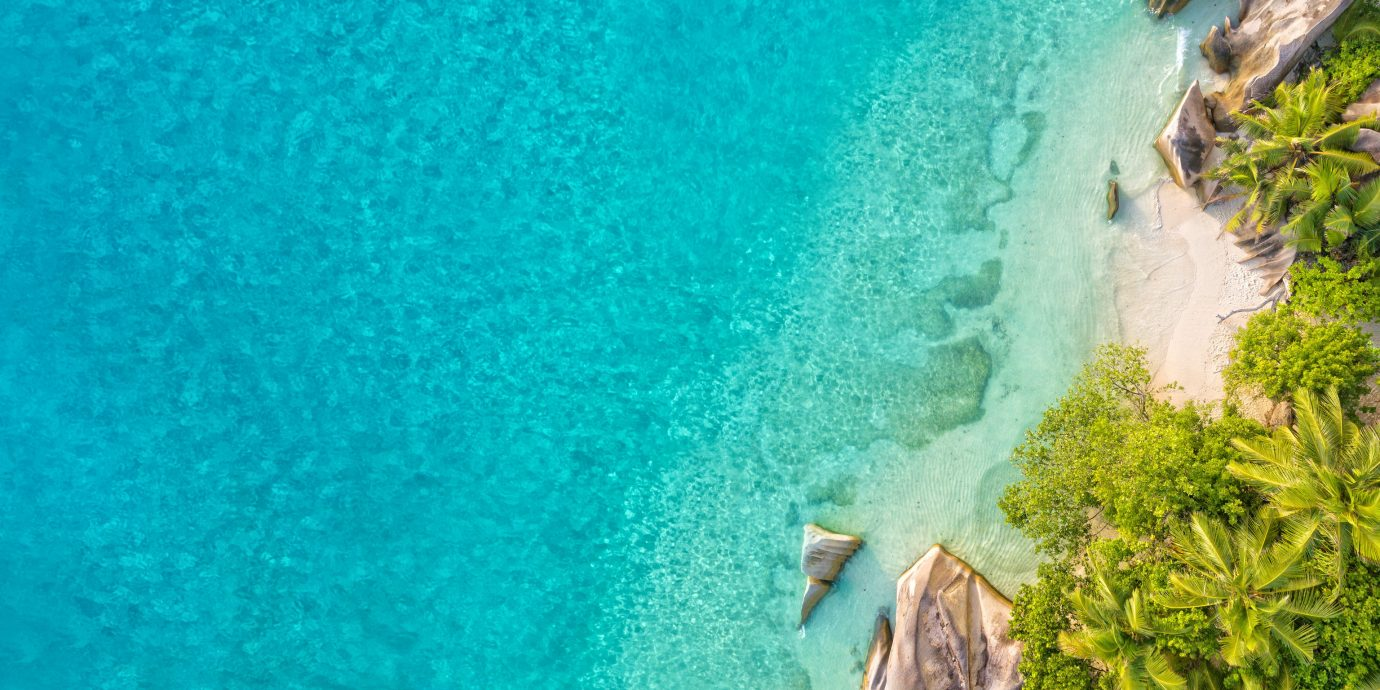 Islands Secret Getaways Trip Ideas water blue Nature green body of water water resources riding aqua Sea azure watercourse water feature water sport sky terrain turquoise Waterfall cliff tree wave vacation Ocean Lagoon coastal and oceanic landforms leisure tropics swimming pool Coast plant swimming ocean floor
