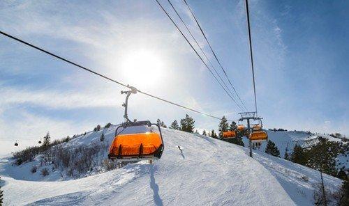 Outdoors + Adventure sky snow outdoor piste ski tow geological phenomenon winter sport Ski skiing ski equipment cable car sports alpine skiing hill day
