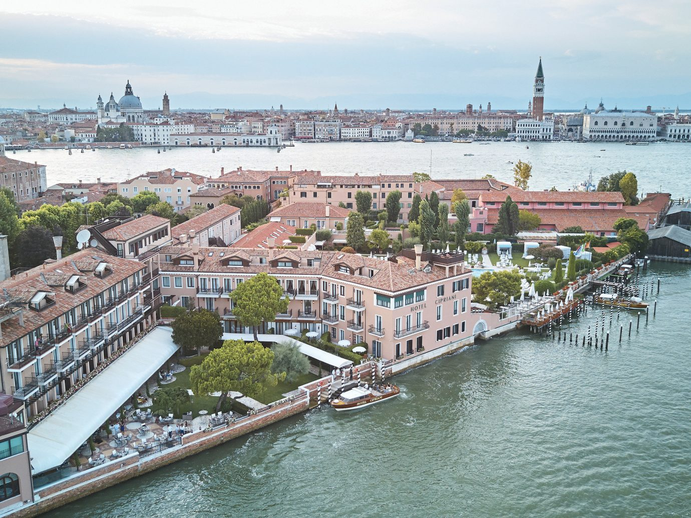 Hotels Italy Luxury Travel Venice waterway City water transportation water River sky channel Canal Harbor Boat port marina cityscape skyline boating watercraft Sea tourism passenger ship bridge