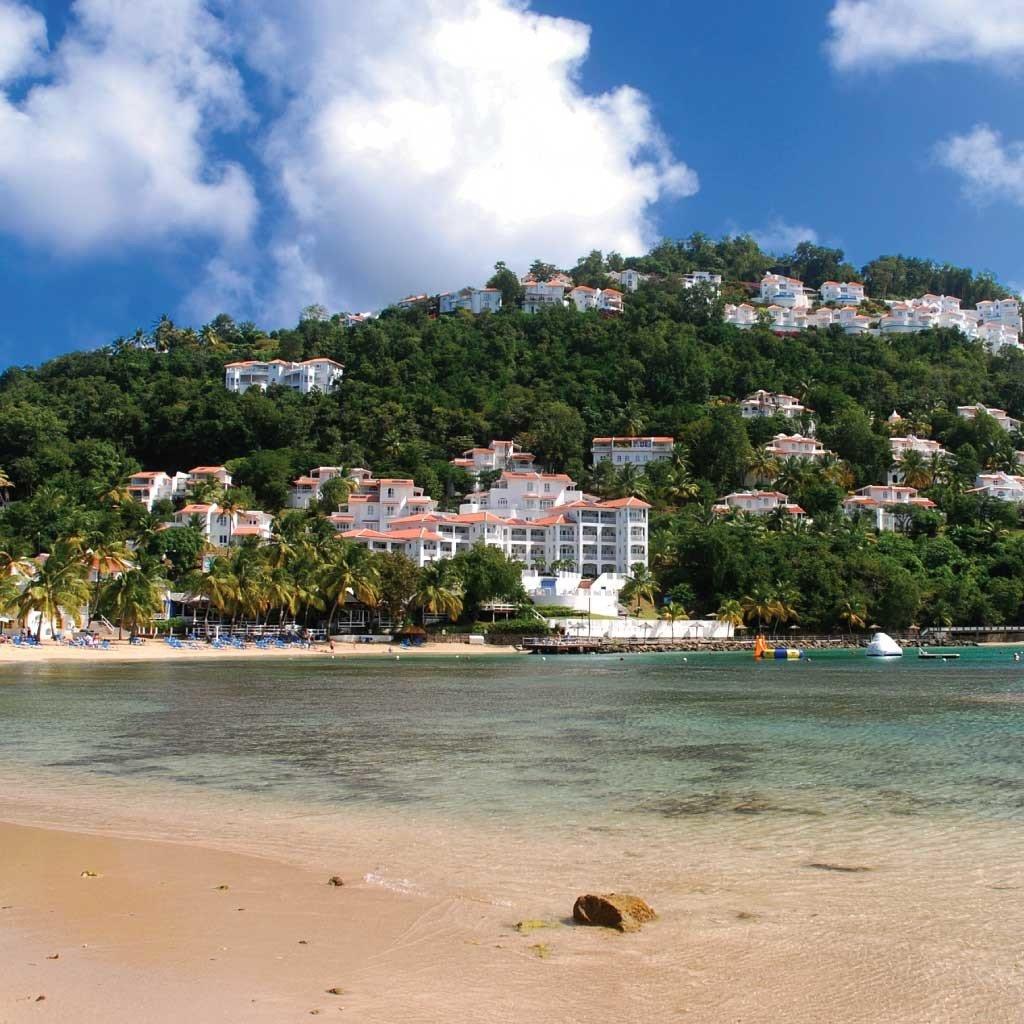 Hotels sky outdoor water Beach Sea body of water shore Coast Nature vacation Ocean bay caribbean tropics cove day sandy