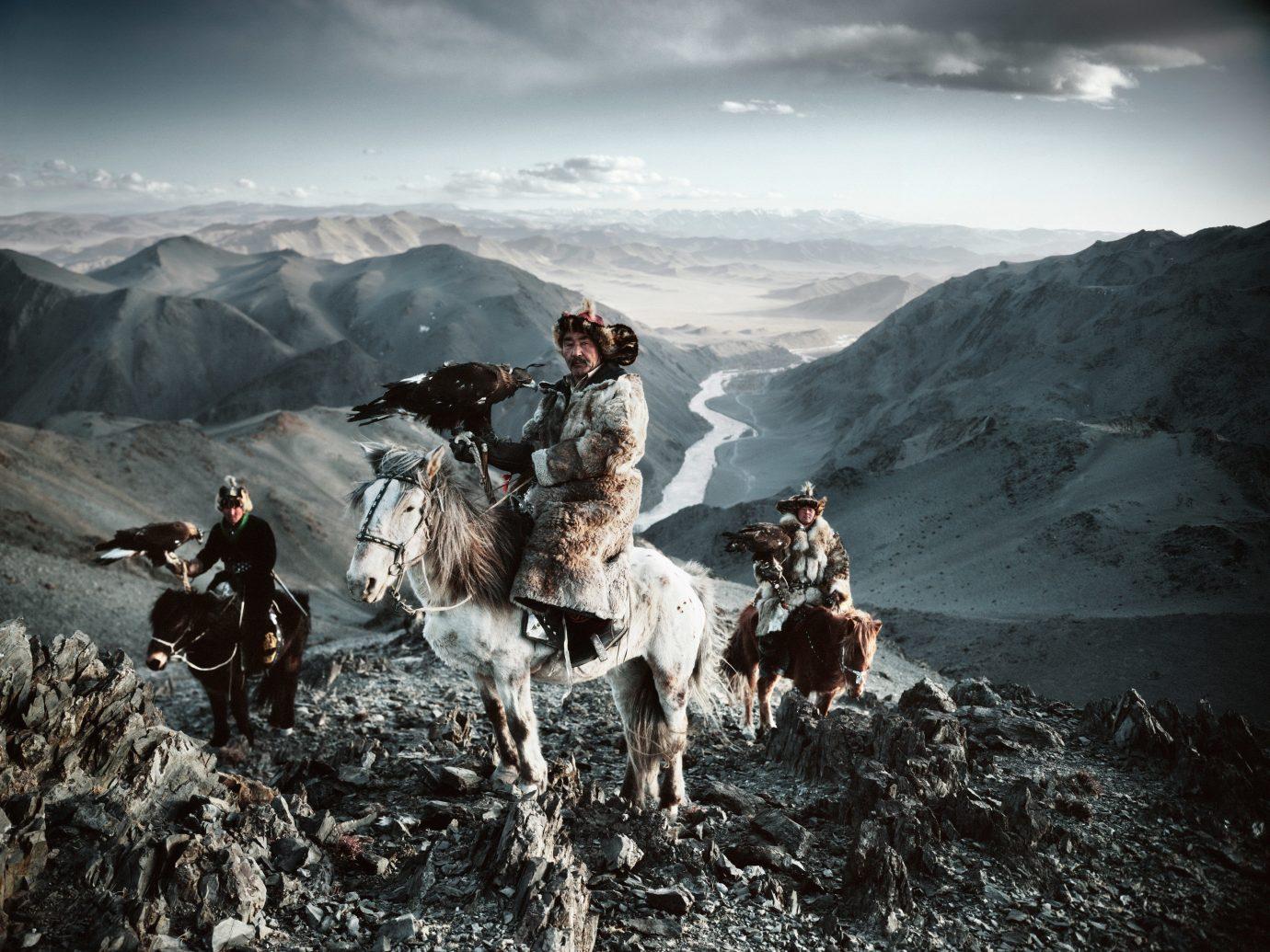 Arts + Culture sky mountain outdoor snow mountainous landforms geological phenomenon standing group people mountain range mammal