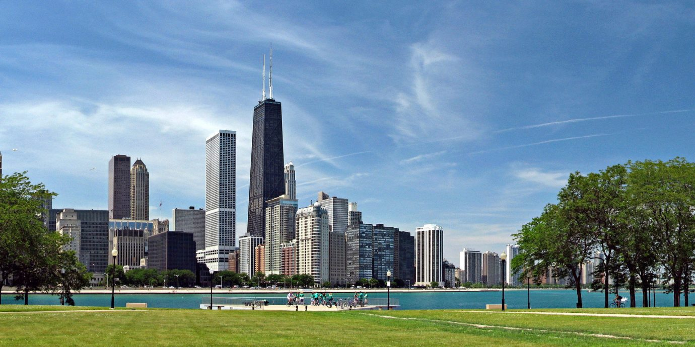 Trip Ideas grass sky outdoor City skyline landmark human settlement skyscraper field cityscape tower block park Downtown residential area plaza town square panorama day