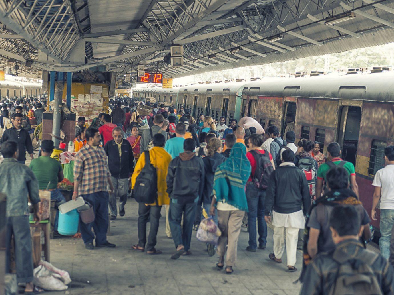 Travel Tips person people crowd group luggage transport indoor waiting station City train market platform public transport passenger marketplace subway several