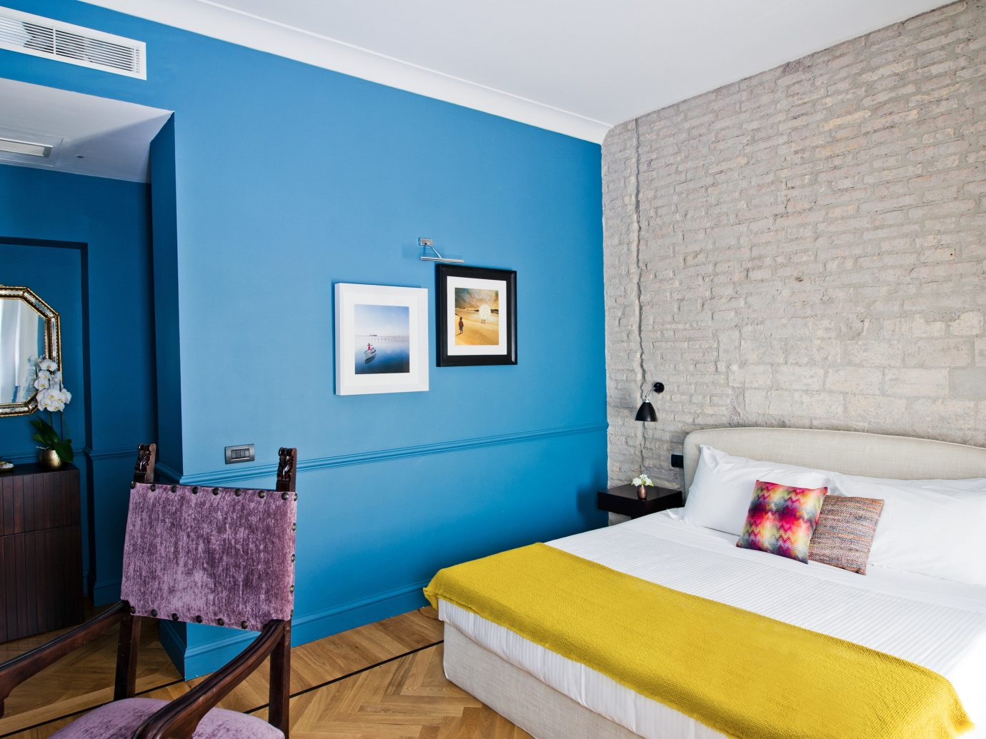 Boutique Hotels Hotels indoor wall blue floor room Suite interior design Bedroom bed ceiling real estate hotel interior designer furniture