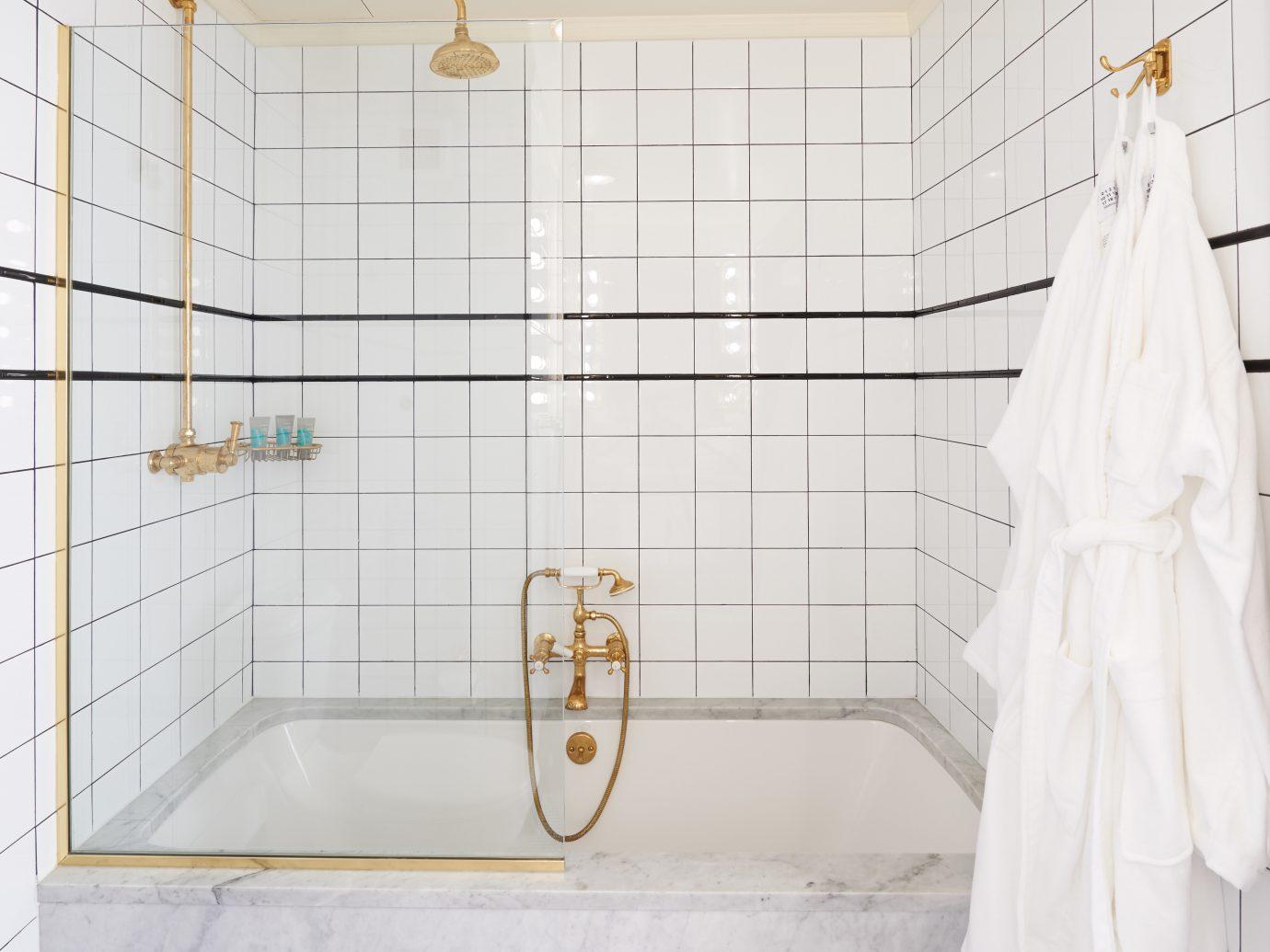 Bath Boutique City Modern Style + Design indoor room bathroom floor flooring bathtub plumbing fixture tile interior design furniture tiled