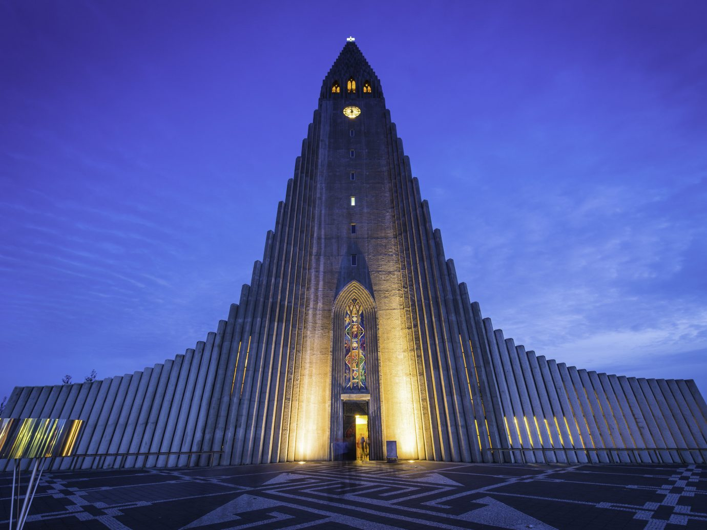 Budget Hotels Iceland Offbeat Outdoors + Adventure Road Trips Trip Ideas outdoor sky tower landmark night building spire place of worship evening cathedral monument symmetry