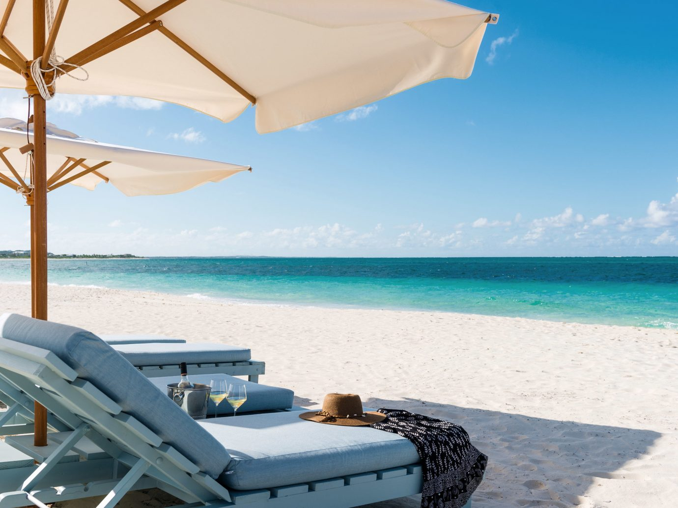 Beach Beachfront Boutique Grounds Luxury Resort Trip Ideas sky water outdoor chair Sea caribbean vacation Ocean Coast swimming pool bay shore