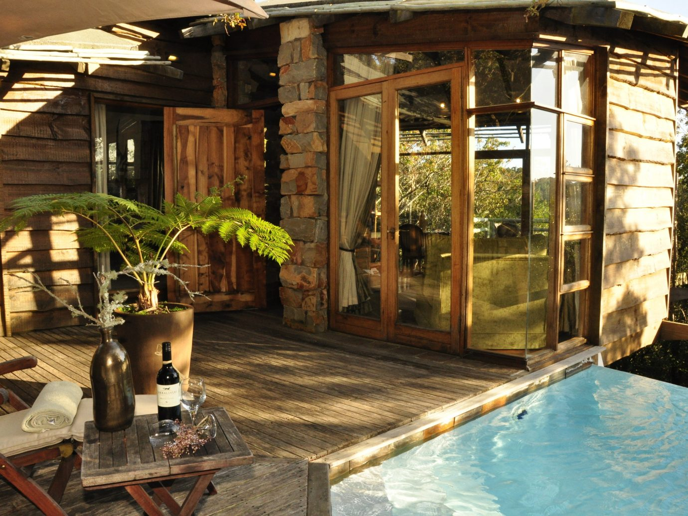 Hotels table building property estate house backyard outdoor structure home cottage swimming pool Courtyard mansion Villa porch log cabin furniture
