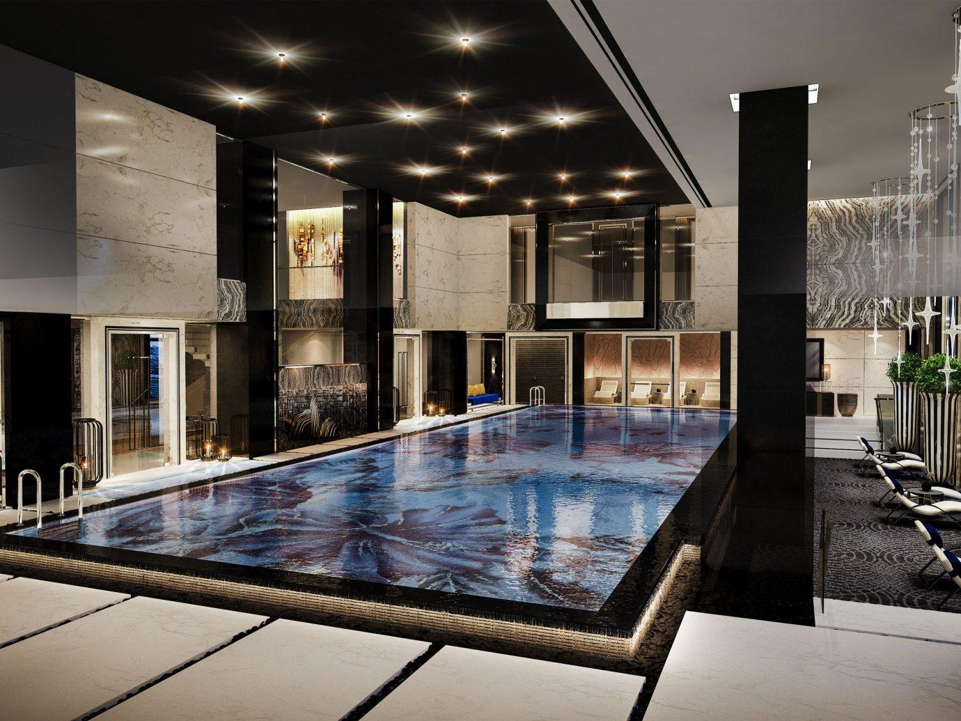 Boutique Hotels Luxury Travel ceiling indoor interior design Architecture condominium apartment Lobby swimming pool real estate daylighting penthouse apartment house estate amenity
