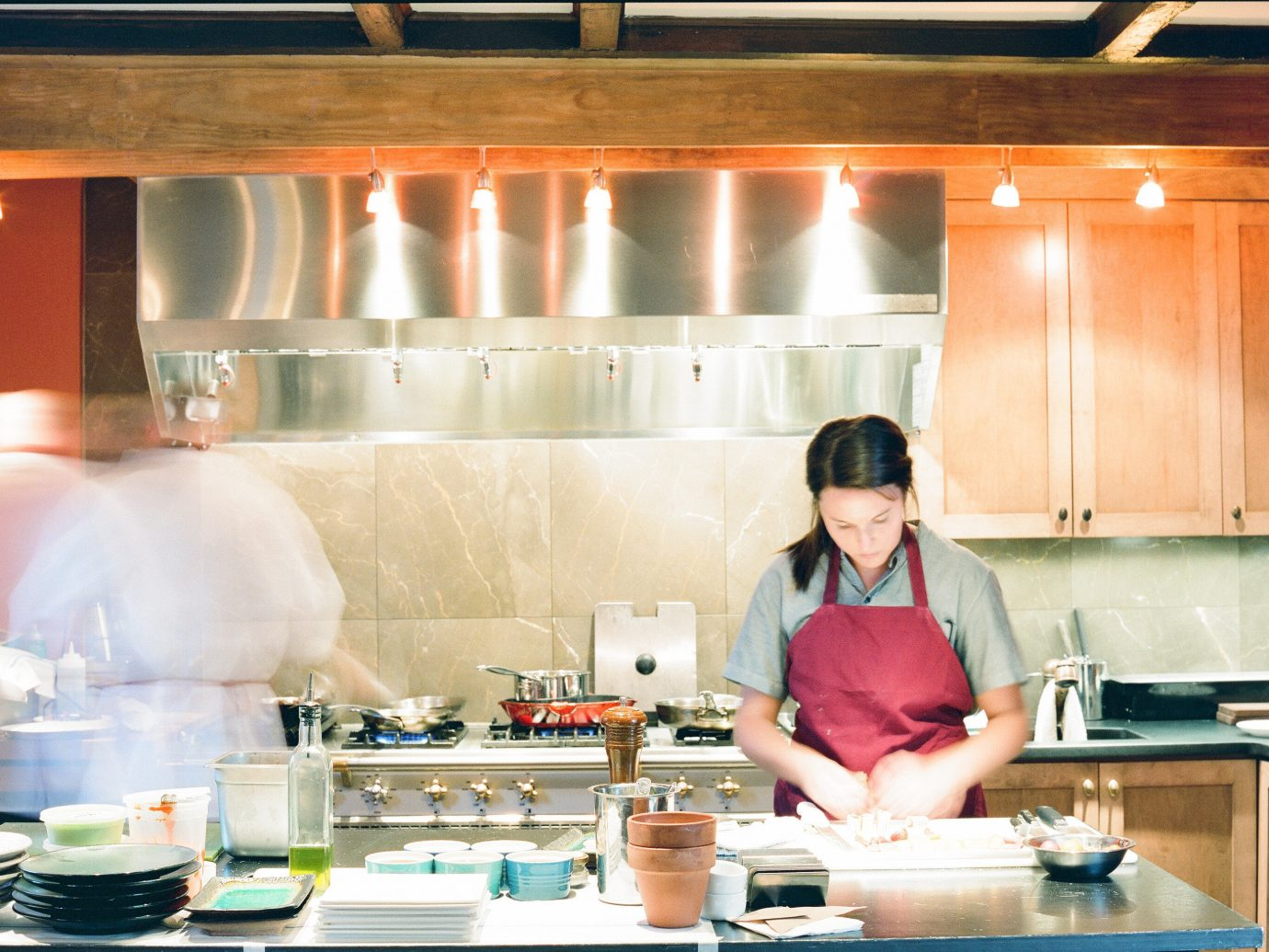 Food + Drink Kitchen indoor person preparing counter meal professional restaurant dish cooking cuisine food cook lunch kitchen appliance