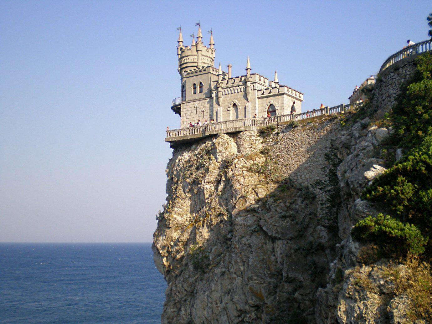 Offbeat outdoor sky water rock tower Sea landmark Coast cliff rocky castle terrain cape fortification stone hillside