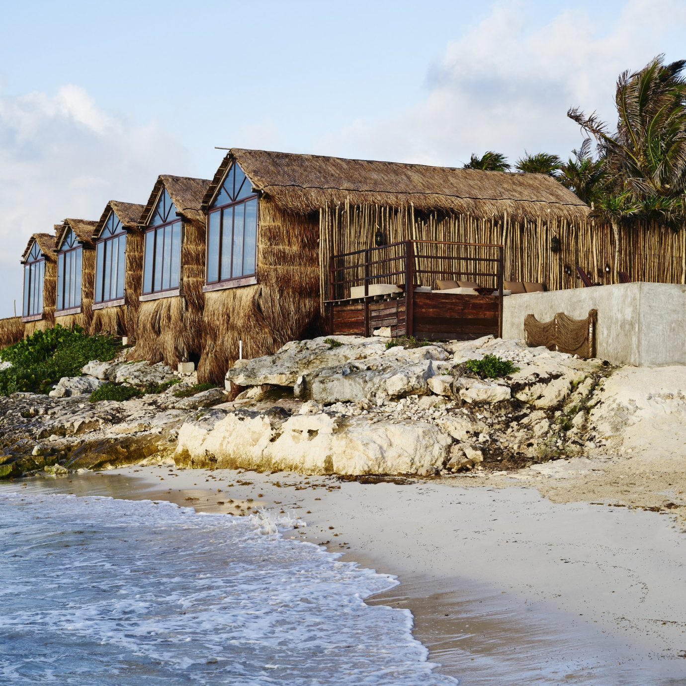 Boutique Hotels Hotels Mexico Tulum sky outdoor body of water house Coast water shore Sea wood Nature real estate cottage Ocean old shack tree rock stone