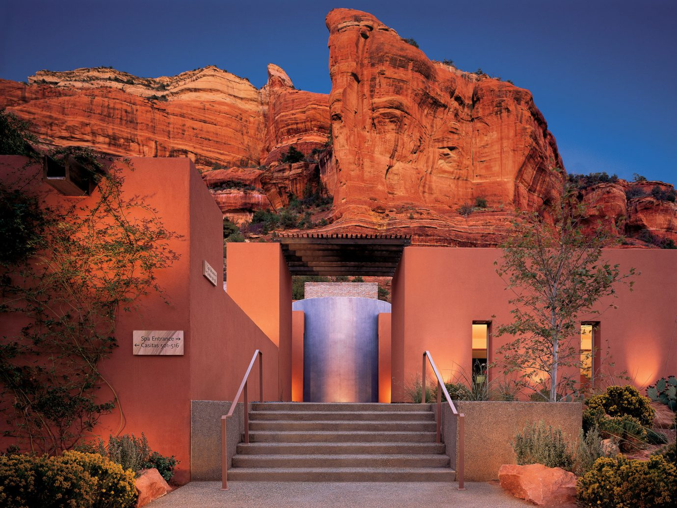 Trip Ideas tree outdoor valley canyon landmark Architecture arch rock landscape estate evening Sunset bushes stone