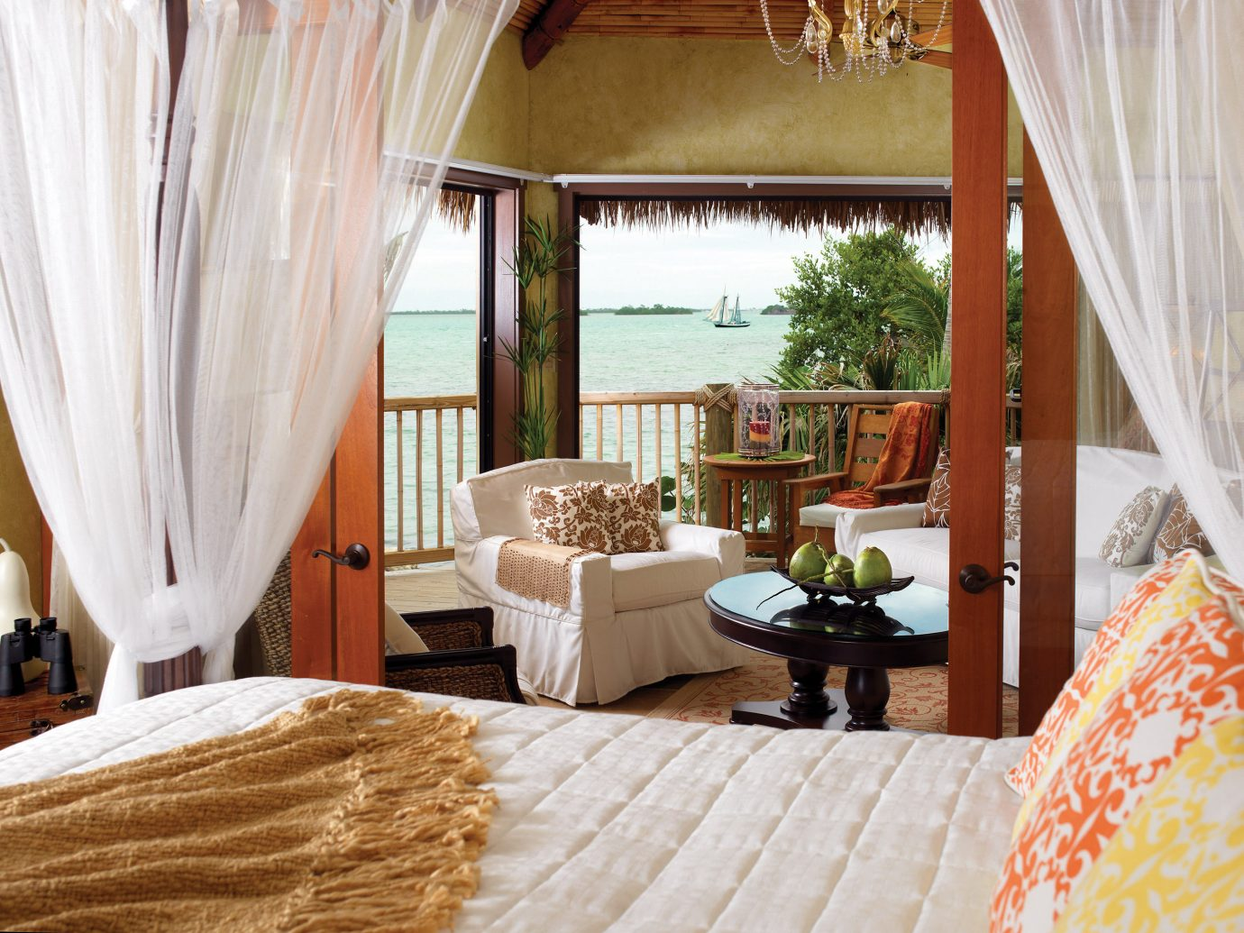 Beach Beachfront Bedroom Hotels Island Resort Romance Romantic Scenic views Waterfront indoor curtain bed room property interior design cottage home Suite estate Villa living room real estate farmhouse furniture decorated