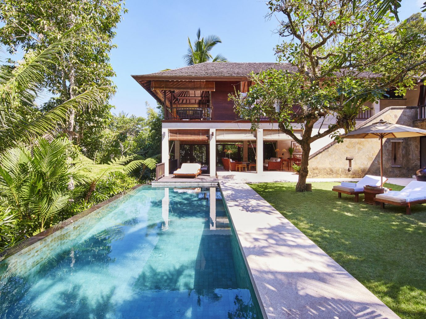 Health + Wellness Hotels tree outdoor grass building property swimming pool house estate Villa backyard Resort home real estate mansion cottage outdoor structure area Garden