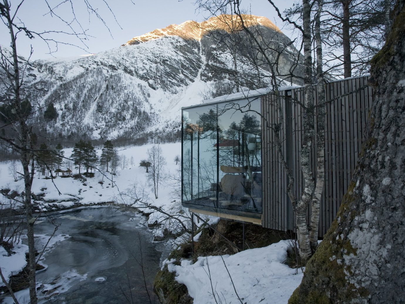 Design Hotels snow outdoor tree Winter covered reflection water freezing geological phenomenon mountain sky mountain range house ice home frost landscape cottage alps slope River plant building