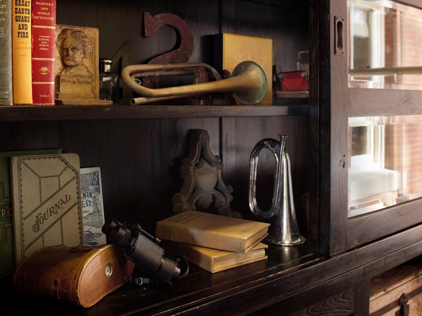 Hotels indoor room shelf living room furniture home interior design wood cluttered