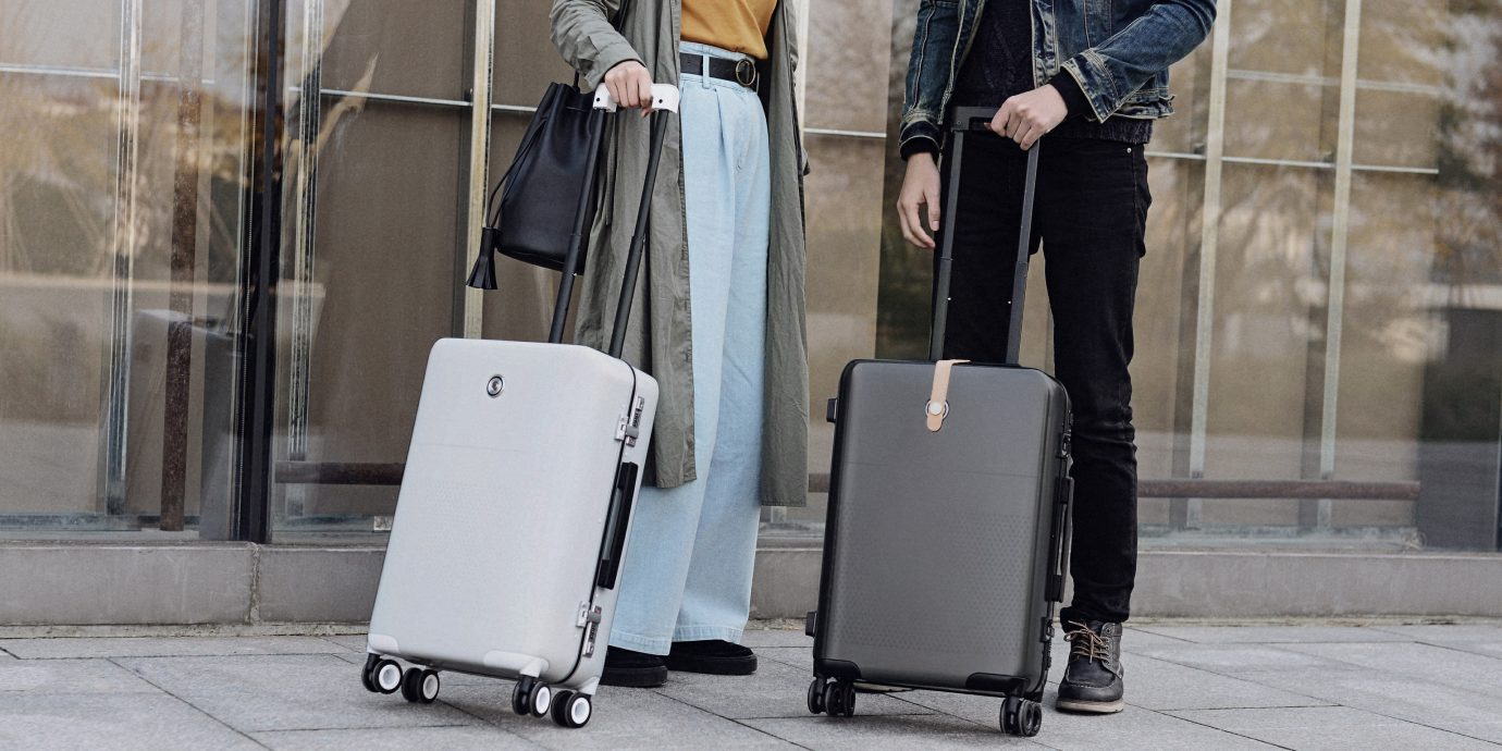 Style + Design Travel Tech Travel Tips person clothing outdoor sidewalk standing footwear street spring way fashion leather outerwear